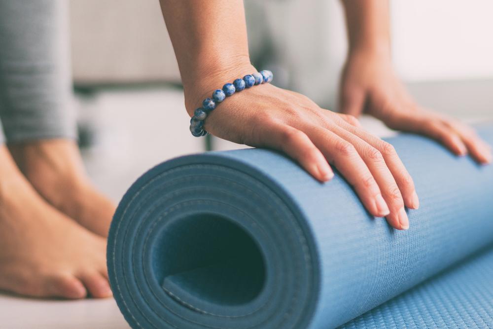 Hands on a yoga mat